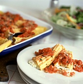 Homemade Manicotti on a Plate and in a Baking Dish