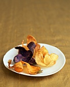 Assorted Potato Chips (White, Blue and Sweet) on a Plate