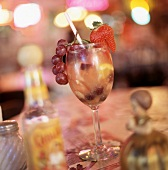A Cocktail with Tequila and Fresh Fruits in a Wine Glass