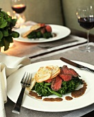 Sliced Flank Steak Over Broccoli Rabe with Thinly Sliced Potatoes