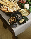 Olives, hummus and savoury baked goods on buffet table