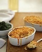 Macaroni and Cheese with Crunchy Topping in a Small Baking Dish and on a Spoon