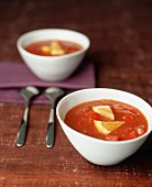 Tomato soup with orange wedges
