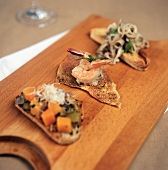 Assorted Hors d'Oeuvres on a Wooden Board