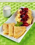 Crepes with Berry Sauce and a Pitcher of Cream