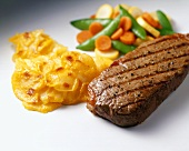 Grilled Beef with Scalloped Potatoes and Mixed Vegetables