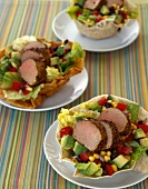 Sliced Pork Tenderloin Over Avocado and Corn Salad in an Edible Tortilla Bowl