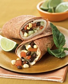 Tomato wraps filled with turkey, black beans and sweetcorn