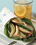 A Spinach Leaf Wrap with Ham, Cheese and Apples