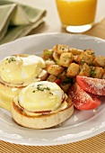 Eggs Benedict with Tomatoes and Home Fries