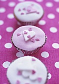 Three cup-cakes with pink hearts for Valentine's Day