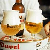 Two Glasses of Duvel Beer with Bottle