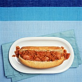 A Chili Dog on Blue from Overhead