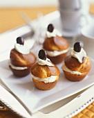 Four small cream puffs with soft cheese cream & coffee bean