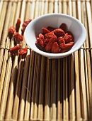 Dried berries in small bamboo bowl on bamboo