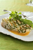 Halibut with chili butter sauce and herbs