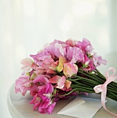 A bunch of pink sweet peas and envelope