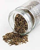 Cumin seed falling out of a jar