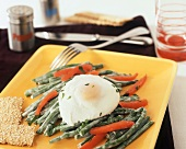 A Poached Egg on Green Bean and Red Bell Pepper Salad