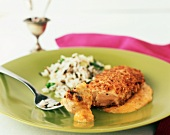 Pecan Crusted Chicken Breast with Apricot Curry Sauce and Rice; Piece of Chicken on Fork