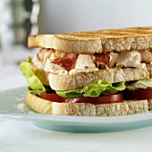 Club sandwich with lobster, mayonnaise, tomatoes & lettuce