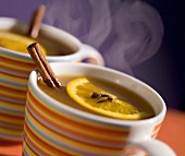 Steaming apple punch with cinnamon sticks
