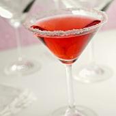 Cosmopolitan in Martini glass with sugared rim