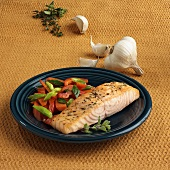 Salmon fillet with peppers and spring onions