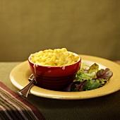 Macaroni cheese, with salad garnish