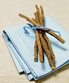 Licorice Sticks Tied with Blue String on a Blue Napkin