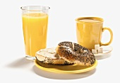 A Poppy Seed Bagel with Orange Juice and Coffee