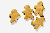 Four Gingerbread People; One with Bite Taken Out