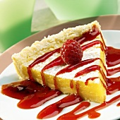 Piece of lemon tart with raspberry sauce