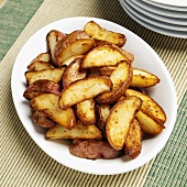 Fried red potatoes on white plate