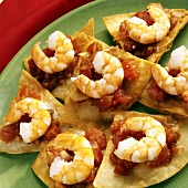 Shrimps and tomato salsa on tortilla chips