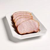 Smoked pork chops on white platter