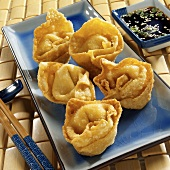 Deep-fried won ton parcels with soy sauce (Crab Rangoon)