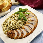 Barbecued chicken breast, sliced, with pesto pasta