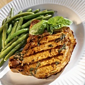 Barbecued pork chop with basil and green beans