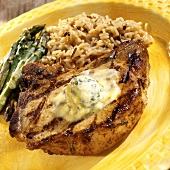 Barbecued pork chop with basil and garlic butter