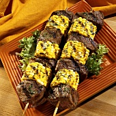 Beef fillet and sweetcorn kebabs with herb butter
