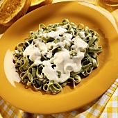 Spinach ribbon pasta with cheese sauce