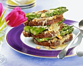 An Open Faced Cheddar Melt with Asparagus and Almonds