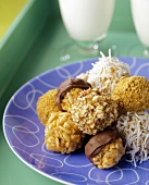 Rows of Peanut Butter Balls, Rolled in Coconut, Rice Krispies, Nuts and Chocolate