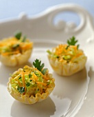 Puff Pastry Hors d'Oeuvres Filled with Cheese and Salad on a White Platter with Handles