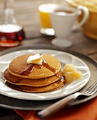 Pancakes with Butter, Syrup and Applesauce
