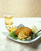 A Risotto Cake on a Bed of Frisee