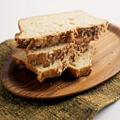 Three Slices of Bread on a Wooden Board