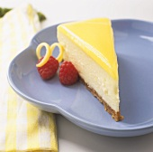 A Slice of Lemon Cheesecake with Raspberries
