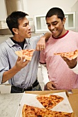 Two Friends Eating Cheese Pizza and Talking